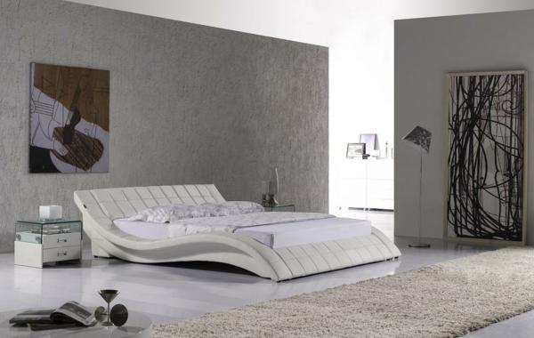 bett-in-weiß-ultramodernes-design- schönes bild an der wand
