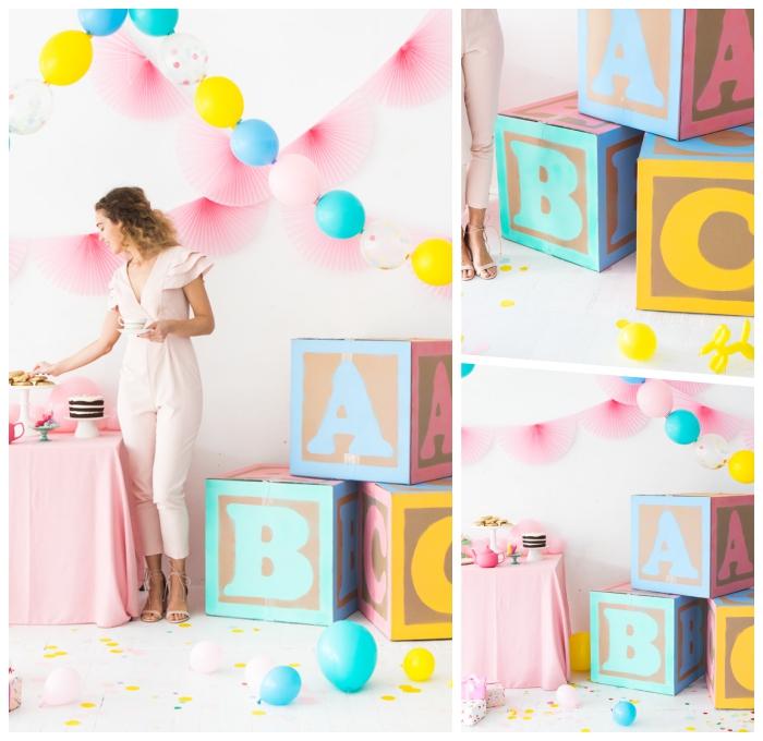 deko erster geburtstag ideen, babyparty organisieren, paortydeko in pastellfarben, goße würfel