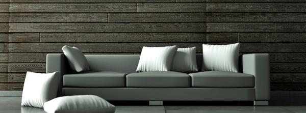 deko   paneele-dunkle-farbe-im-wohnzimmer - graues sofa mit dekokissen
