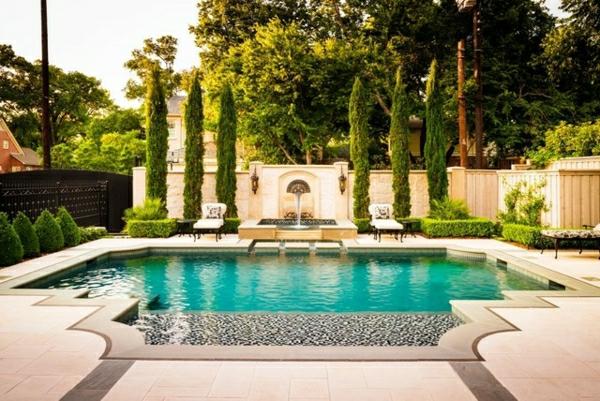 dekosteine-für-garten-kies-neben-dem-pool - pflanzen