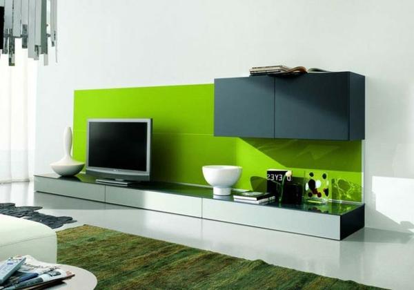 exklusive-tv-möbel-in-grün- im wohnzimmer mit weißen wänden