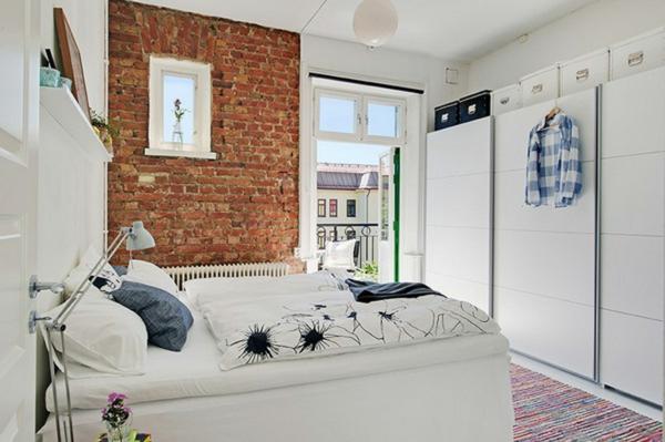 schön aussehendes schlafzimmer - skandinavisches design - eine ziegelwand