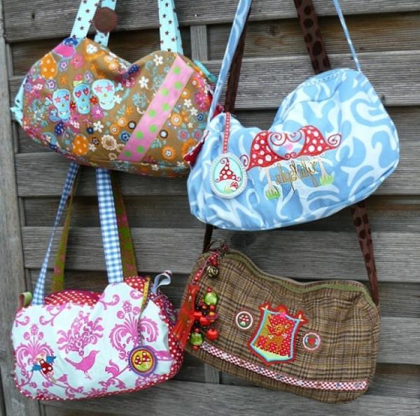 kreatives-nähen-vier-handtaschen- aufgehängt