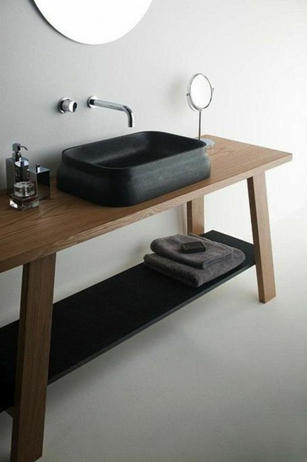 minimalistisches-waschtisch-in-schwarz-auf-einem-holztisch