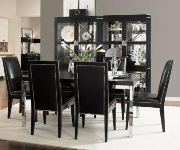 moderne-glasvitrine-in-schwarz-im-esszimmer- weiße blumen auf dem ...