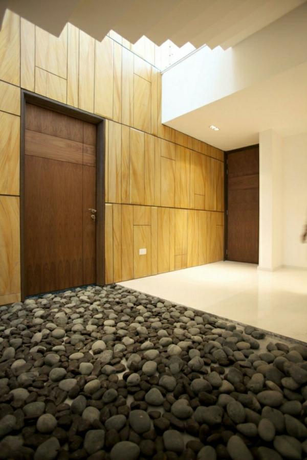 moderne-wohnung-mit-steinen-dekoriert - großer flur