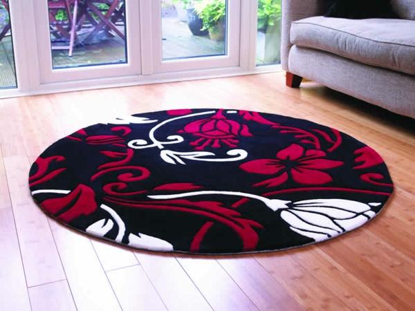 modernes-beispiel-für-kleine-runde-teppiche- in rot, schwarz und weiß