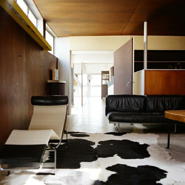 relax-liegestuhl-schöne-zimmergestaltung - mit einem teppich in weiß und schwarz