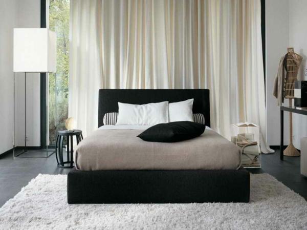 Schlafzimmer-mit-Teppich-in-weißer-Farbe