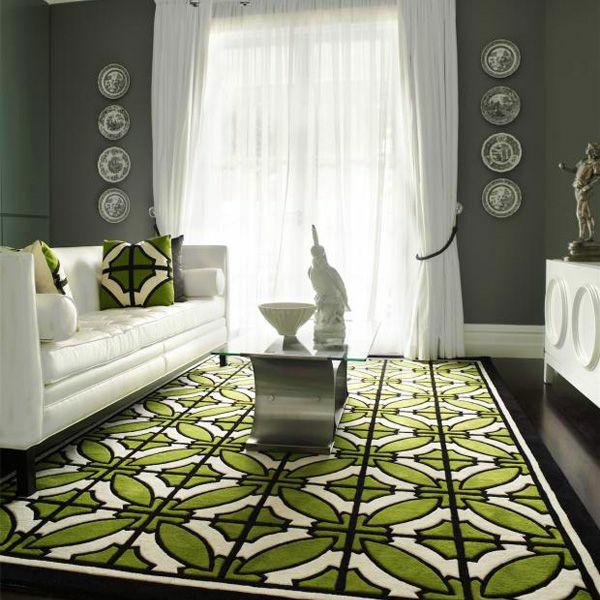 Teppich-in-Grün-mit-geometrischen-Figuren