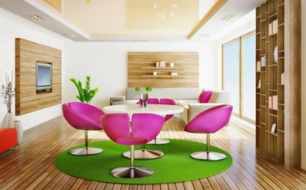 Wohnzimmer-mit-grünem-Teppich-rosa-Stühle