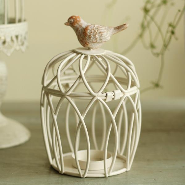 deko-vogelkäfig-mit-einem-künstlichen-vogel-darauf