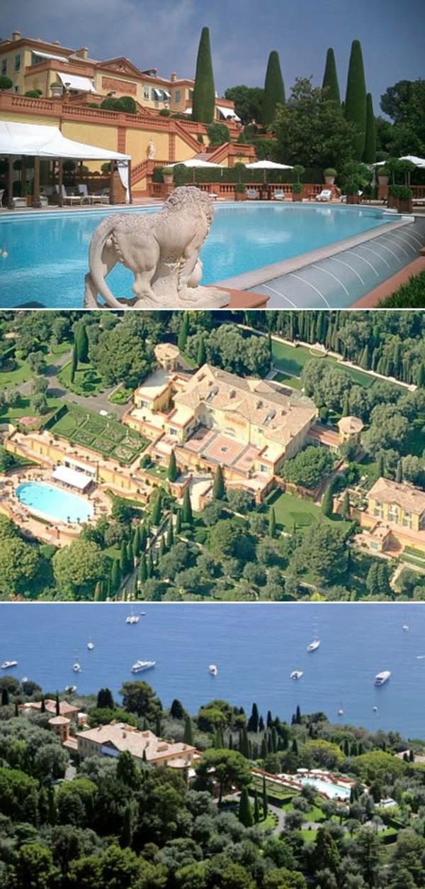 haussuche-beste-häuser-auf-der-welt-villa-leopolda-in-frankreich - mit einem löwen - neben dem pool