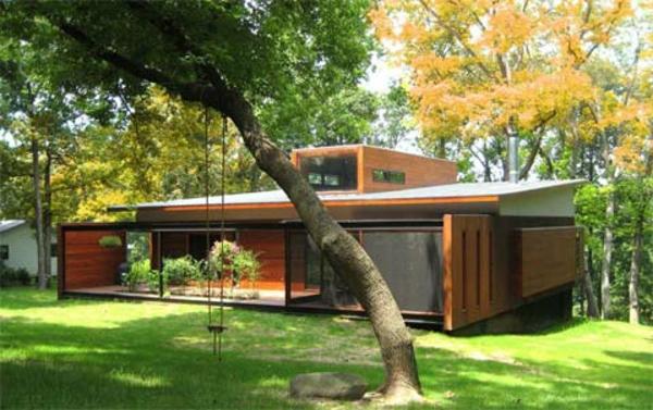 kleines-haus-bauen-mit-schöner-grünen-umgebung - flaches dach
