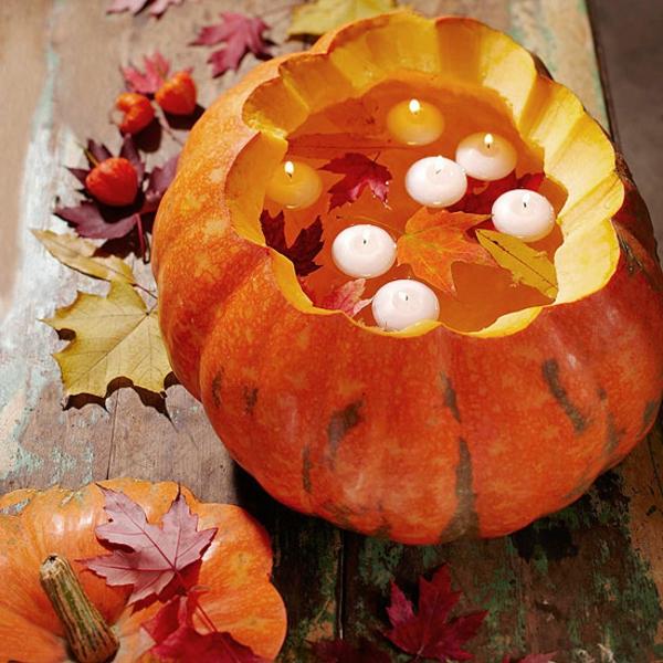 süß-aussehen-halloween-deko-ideen - kürbis mit kerzen