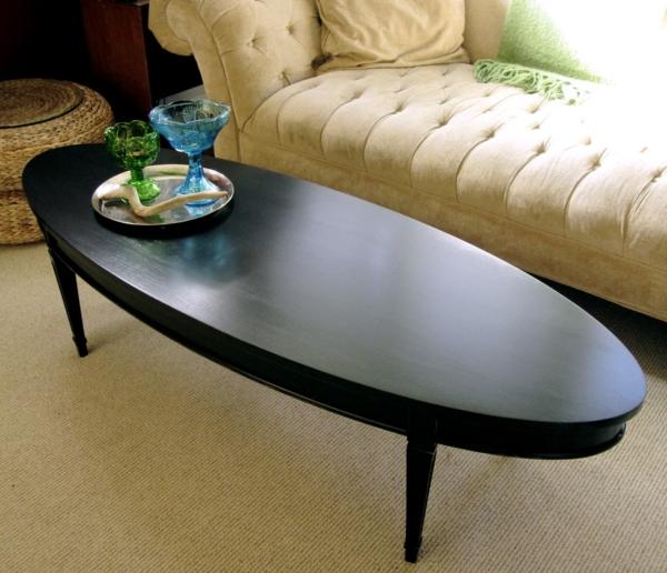 schwarzer-couchtisch-ovalförmig