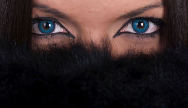 Beautiful woman with blue contact lenses covering her face