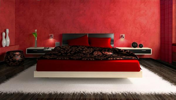 modernes bett in rot und schwarz im luxuriösen schlafzimmer