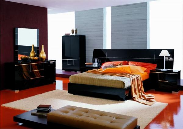 elegantes schlafzimmer mit orangen akzenten