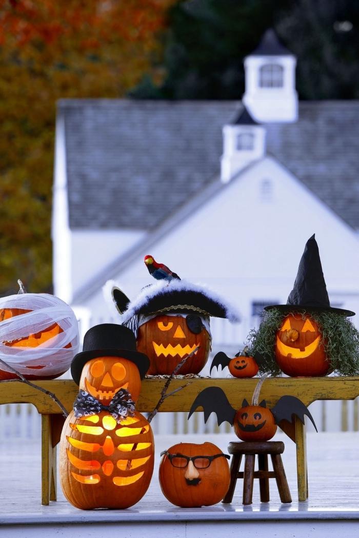 kürbisgesichter schnitzen, kürbis gesicht, halloween deko, pirat, hexe