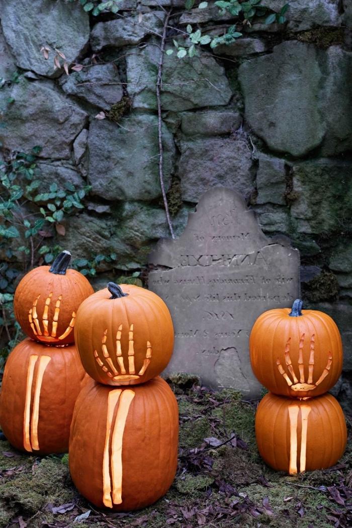 kürbis halloween, kürbisdeko selber machen, garten dekorieren, arme