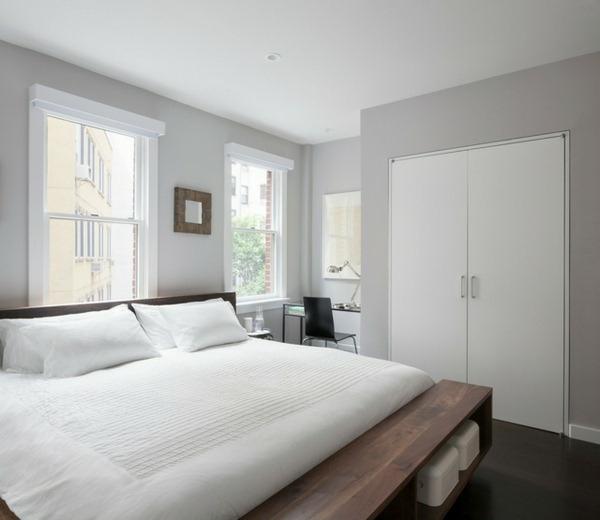 wandfarbe-hellgrau-im-schlafzimmer-mit-einem-weißen-bett