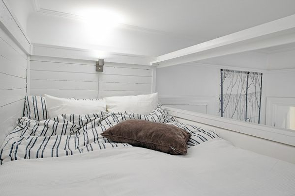 weiße-skandinavische-einzimmerwohnung-einrichten