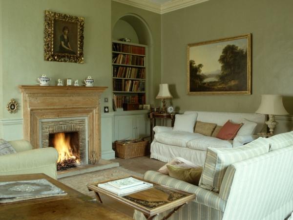 cooles bild wohnzimmer:elegantes wohnzimmer mit grünen wänden und einem kamin