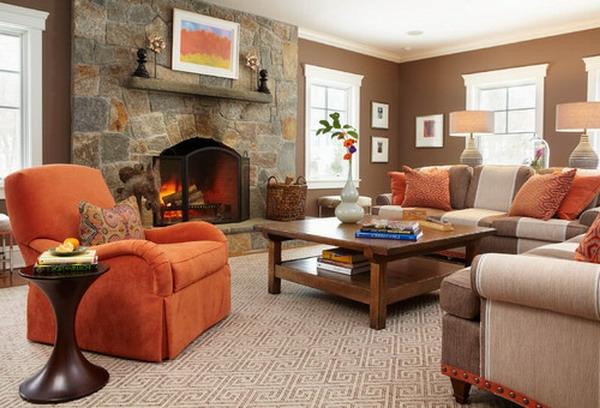 wohnzimmer-ideen-kamin-und-orange-sessel