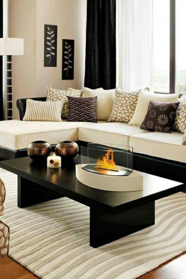 wohnzimmer olivgrün:elegantes-Wohnzimmer-mit-schwarzem-Kaffeetisch-Wohnzimmer-Einrichtung