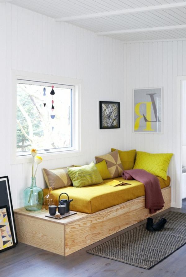 gestaltungsmöglichkeiten-für-wohnzimmer-gelbe-dekokissen