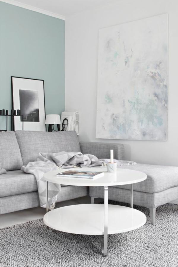 gestaltungsmöglichkeiten-für-wohnzimmer-weißer-runder-tisch