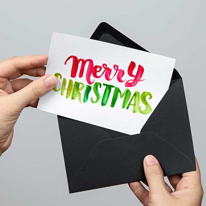 DIY Weihnachtskarten Ideen, Aufschrift Merry Christmas mit Aquarellfarben malen
