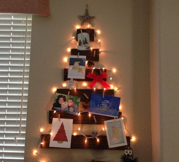 karten-selber-basteln-wunderschöner-tannenbaum-aus-weihnachtskarten-leuchtendes-modell