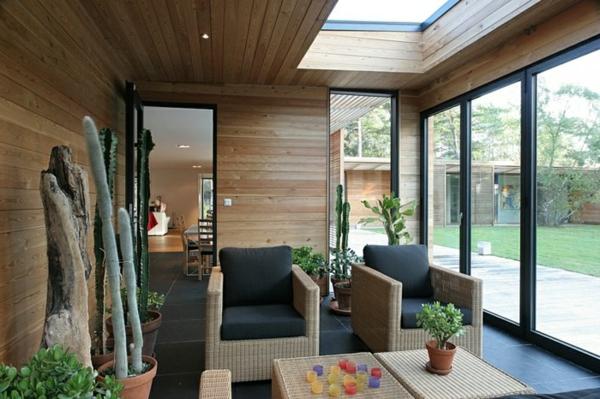 Wintergarten gestalten: moderne Möbelstücke und exotische Pflanzen ...