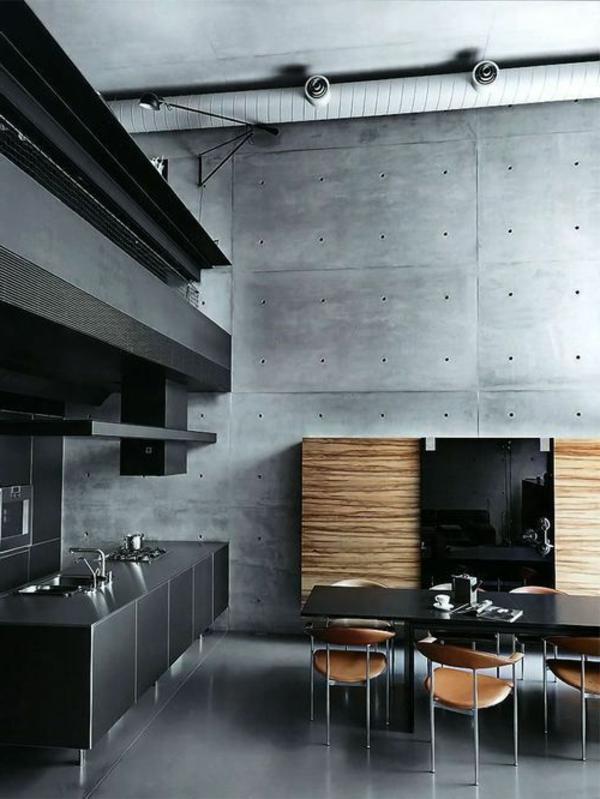 moderne-küchenmöbel-im-attraktiven-dunklen-wohnraum-mit-einem-esstisch