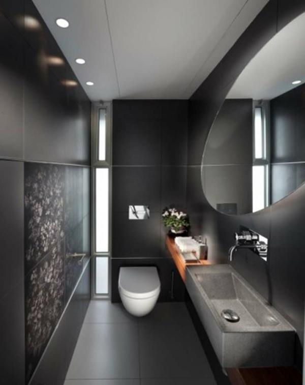 schwarzes-badezimmer-mit-einem-luxuriösen-spiegel