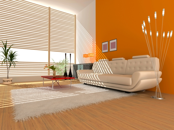 wohnzimmer orange weiß:weiße jalousien im schicken wohnzimmer mit einer orangen wand