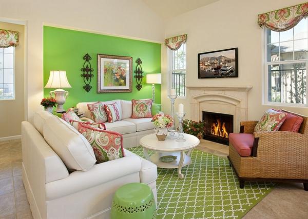 coole wohnzimmer farben:schöner kamin und grüne wand im gemütlichen wohnzimmer