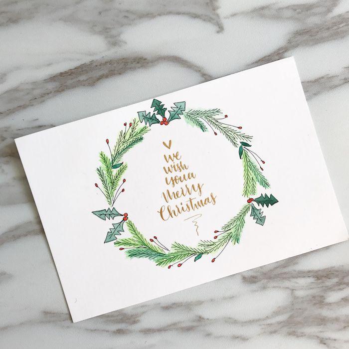 Weihnachtskarte mit einem simplen Design selber machen, einfachen Kranz malen, Wunsch in der Mitte