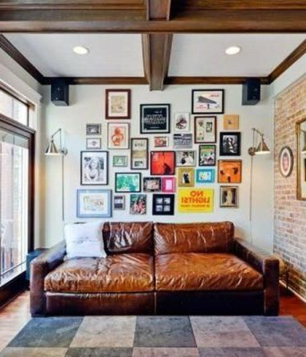 wohnzimmer einrichten - ledersofa in brauner farbe