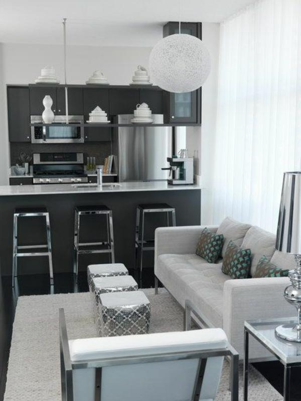wohnzimmer einrichten - eine moderne küche daneben