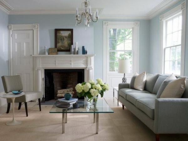 wohnzimmer einrichten - tisch aus glas und feuerstelle