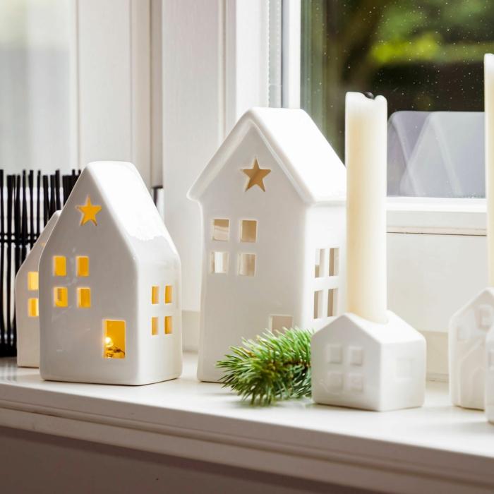 fensterbank deko zu weihnachten selber machen teekerzen in keramikhäusern anzünden weihnachtsdeko