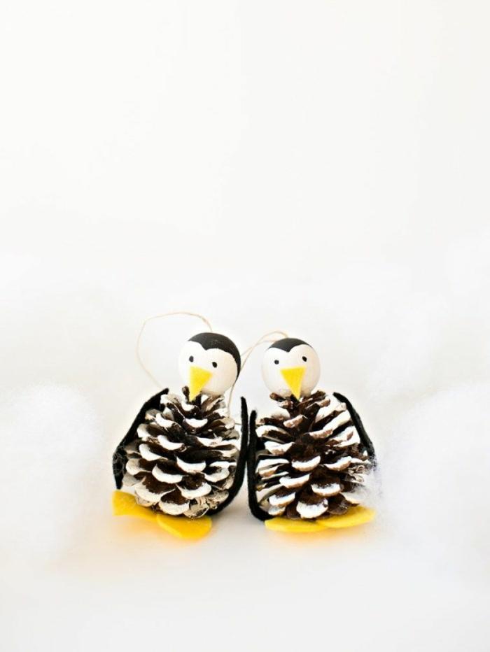 fensterdeko weihnachten basteln pinguine aus zapfen und filz diy machen