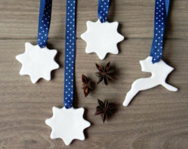 weiße weihnachtsdeko - dekorative sterne, die man aufhängen kann