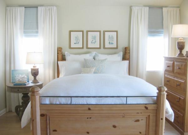 kleines-schlafzimmer-einrichten-hölzernes-bett-mit-hellen-bettwäschen
