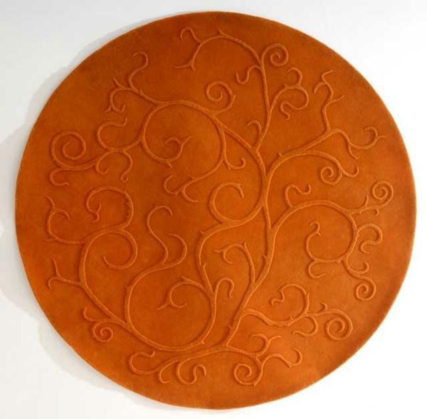 orange-runder-teppich-weißer-hintergrund