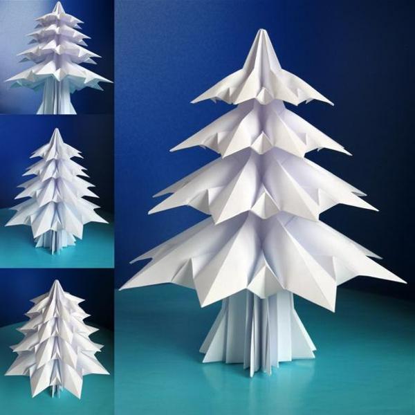 origami-zu-weihnachten-weißer-schöner-tannenbaum - hintergrund in blauer farbe