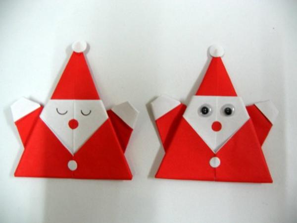 origami-zu-weihnachten-weihnachtsmänner an der weißen wand